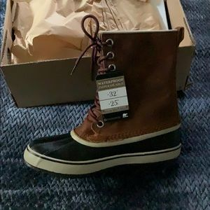Never worn Sorel boots, size 10.5